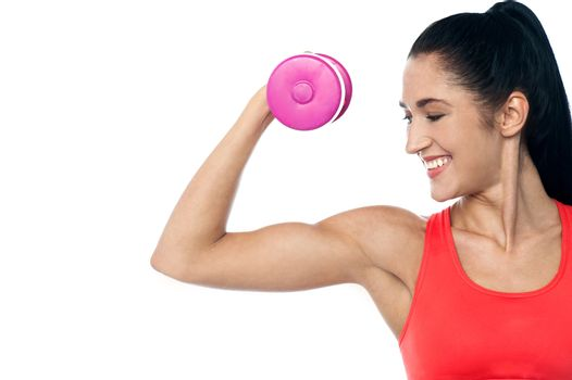 Pretty woman working out with dumbbell