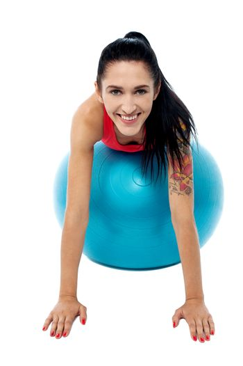 Young fit woman doing aerobics