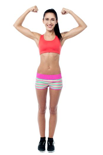 Female trainer showing her biceps