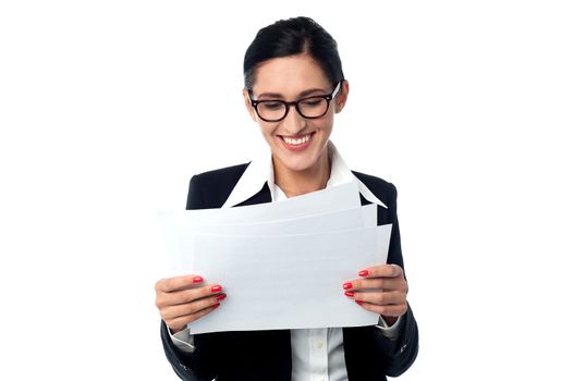 Manager smilingly looking at business reports