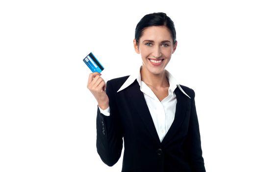Corporate woman displaying credit card