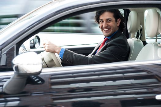 Corporate man driving his car