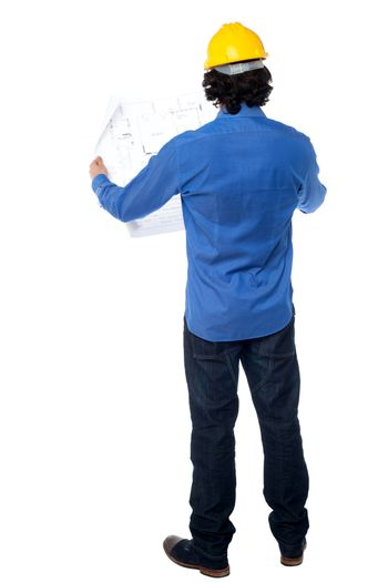 Construction worker with blueprint plan
