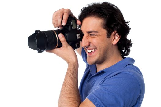 Young man taking a picture of his friend