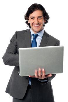 Businessman operating his laptop