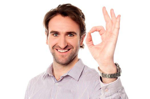 Smart man showing okay sign