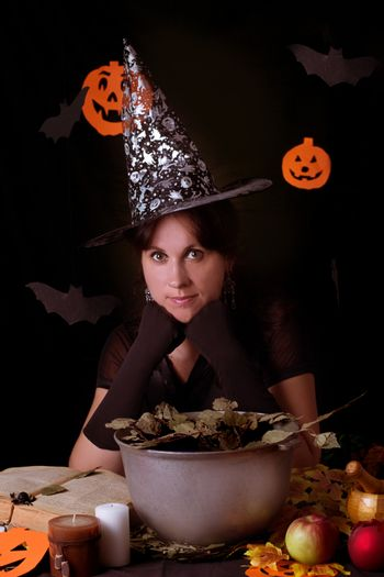 Witch practicing sorcery at Halloween night