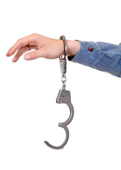 Unlocked Handcuffs on a Hand
