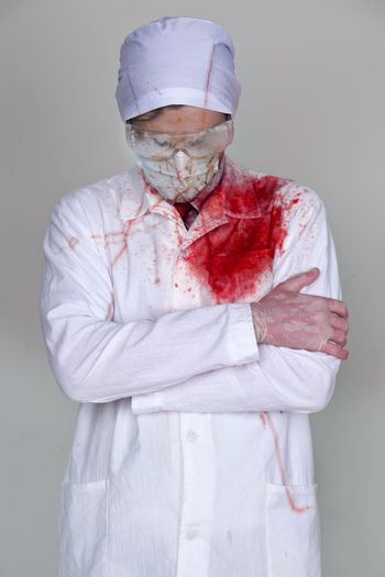 Doctor in a bloody robe