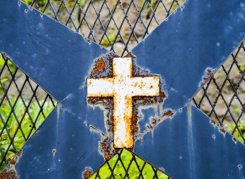 Rusty cross on steel