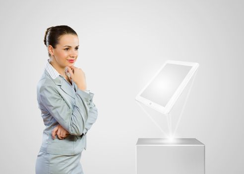 Image of businesswoman and white tablet pc. New technologies