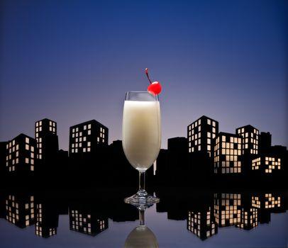 Metropolis Pina colada cocktail in city skyline setting