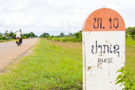10 kilometer milestone and direction sign to Pakson to Pakse, La