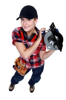 Woman holding circular saw
