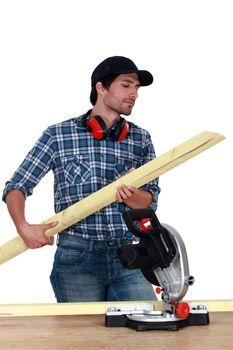 Carpenter cutting wooden slats