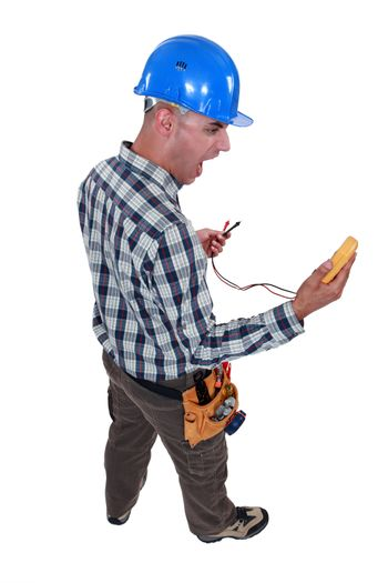 electrician looking at his measurement tool and screaming of surprise