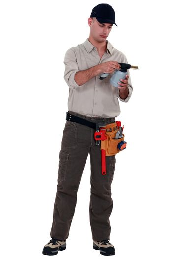 Man reading blow torch instructions