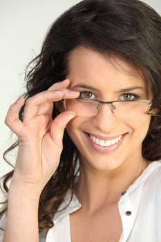Brunette touching glasses fame