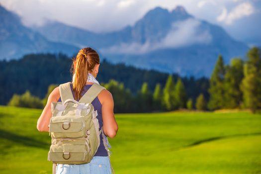 Traveler girl in the mountains