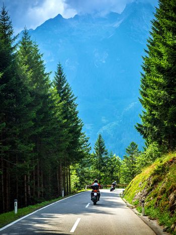 Bikers on the road in Alps