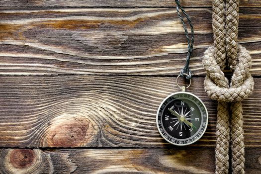 Wood texture with marine knot and compass
