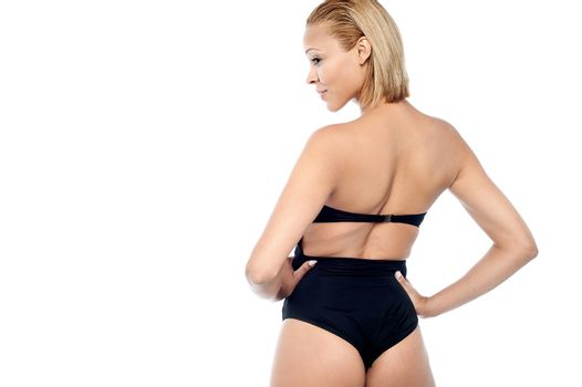 Back pose of a young fashion model