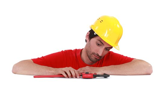 Man with a pipe wrench