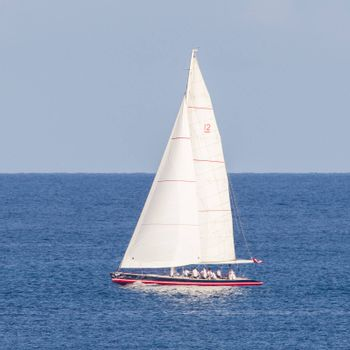 Small sailboat sailing on the Caribbean sea