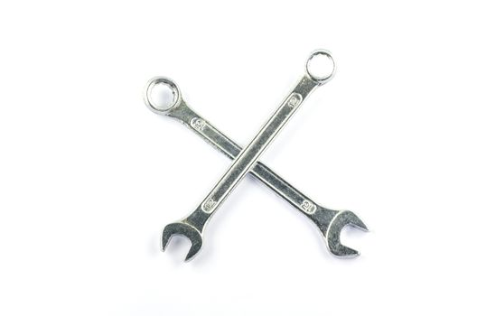 two wrench cross isolated on white background