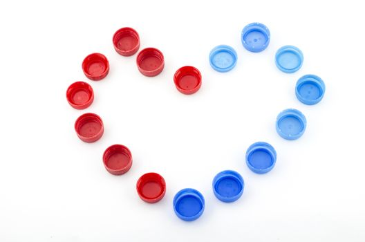 red blue heart bottle cap isolated on white background