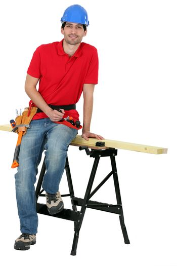 A carpenter seating on a workwrench.