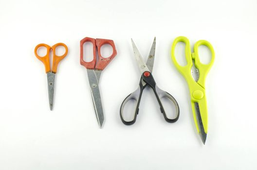 four used Scissors isolated with white background