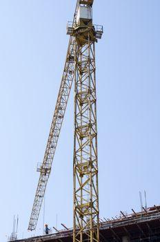 crane on blue sky background