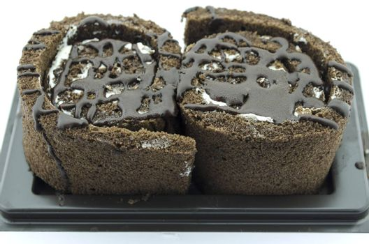 chocolate cake roll isolated on white background