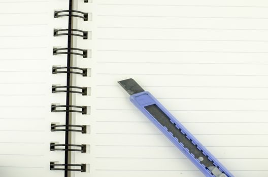 cutter on notebook background texture