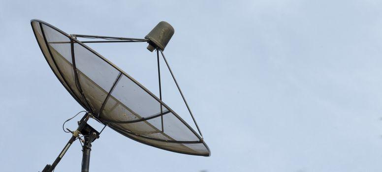 Satellite dish on blue sky background