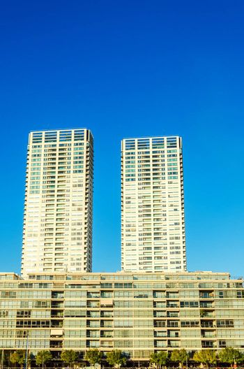 Facades of tall apartment buildings in the Puerto Madero neighborhood of Buenos Aires