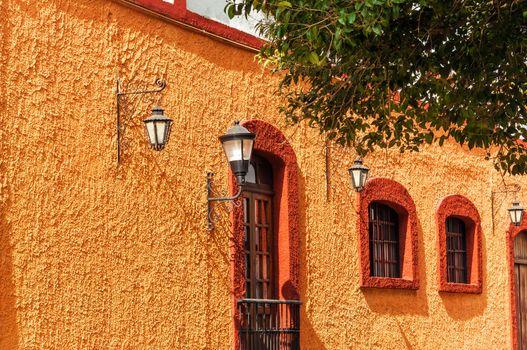 Orange and red colonial wall in San Cristobal de las Casas in Mexico