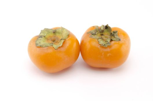two persimmon isolated on white background