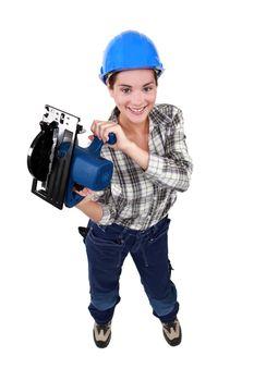 Tradeswoman holding a circular saw