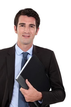 Confident businessman holding folder underarm