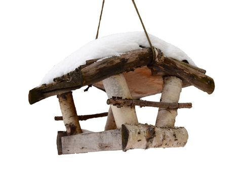 Seasonal Winter Isolation Of Snow Covered Bird House With Clipping Path