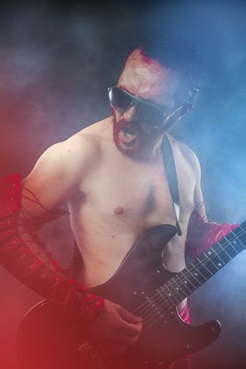 Rock star playing solo on guitar. passionate guitarist