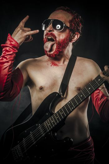 Heavy metal. Rock star playing solo on guitar