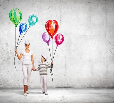 Image of young happy smiling family walking