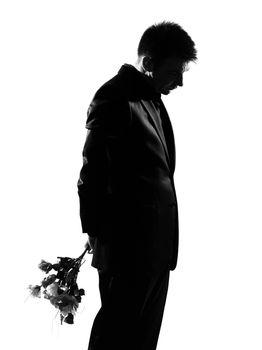silhouette caucasian business man offering flowers expressing behavior full length on studio isolated white background