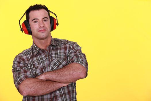 Handyman wearing red protective ear muffs