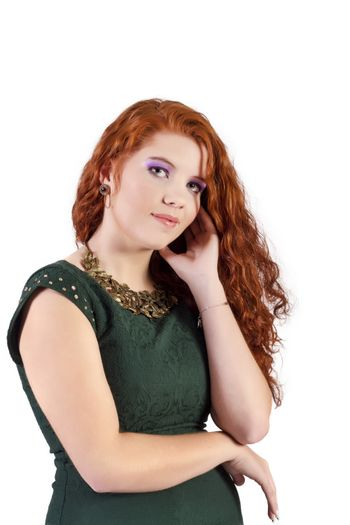 View of a beautiful young natural red hair woman with night fashion clothing isolated on a white background.