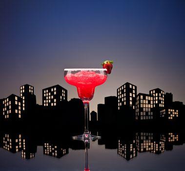 Metropolis strawberry Margarita  cocktail in city skyline setting