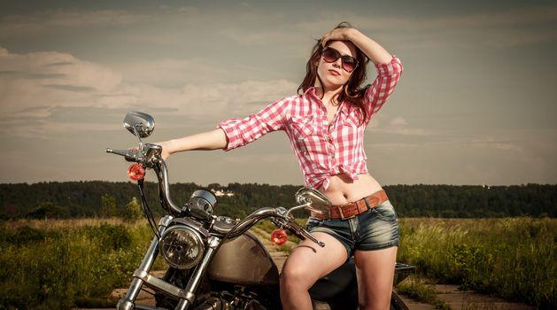Biker girl and motorcycle